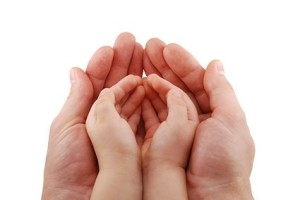 adult_hands_holding_baby_hands_stock_photo_167875